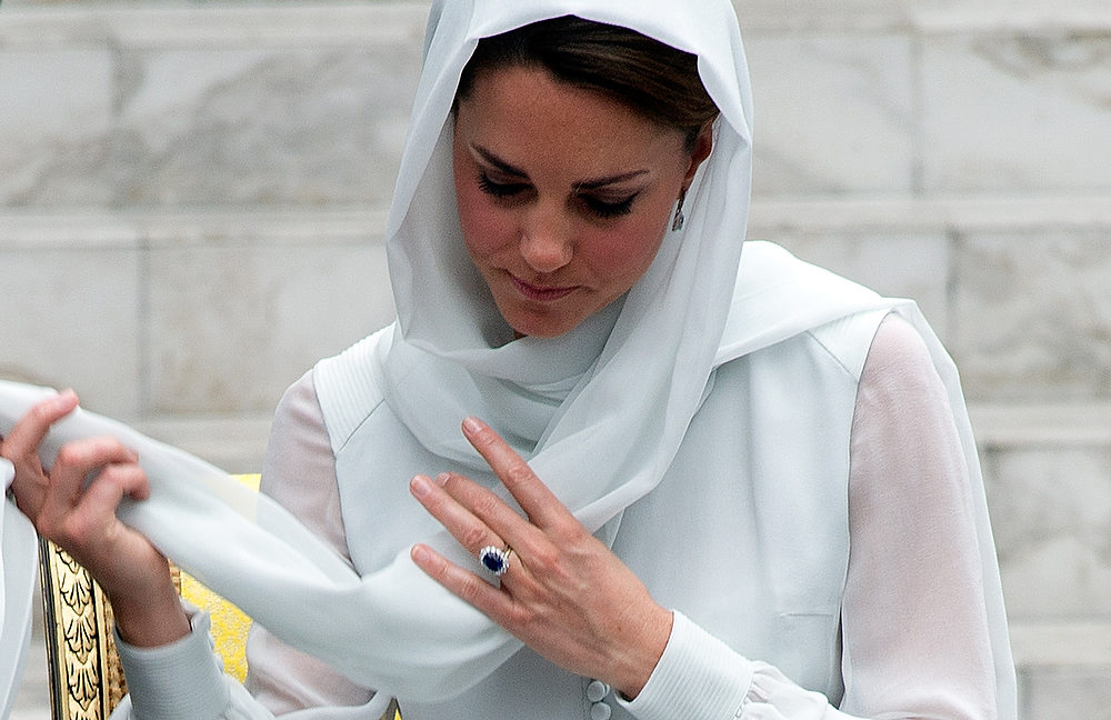 . Britain\'s Prince William\'s wife Catherine, the Duchess of Cambridge adjusts her scarf outside a mosque at KLCC in Kuala Lumpur on September 14, 2012, on the second leg of a nine-day Southeast Asian and Pacific tour marking Queen Elizabeth II\'s Diamond Jubilee. SAEED KHAN/AFP/Getty Images