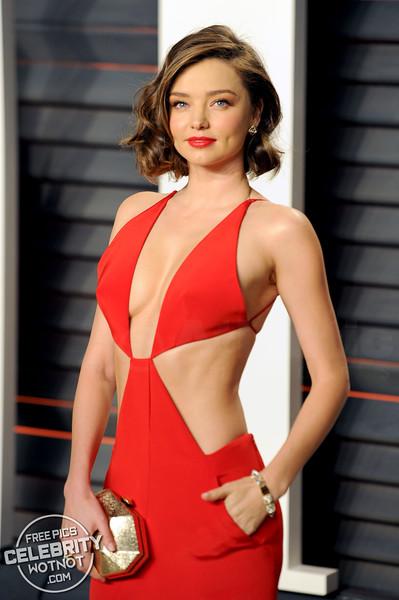 Miranda Kerr Shows Off Cleavage In Revealing Kaufman Franco Gown To Vanity Fair Oscar Party, LA