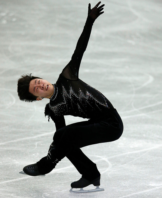 . Wang Yi of China performs during the men\'s short program event at the ISU Four Continents Figure Skating Championships in Osaka, Japan, Friday, Feb. 8, 2013. (AP Photo/Shizuo Kambayashi)