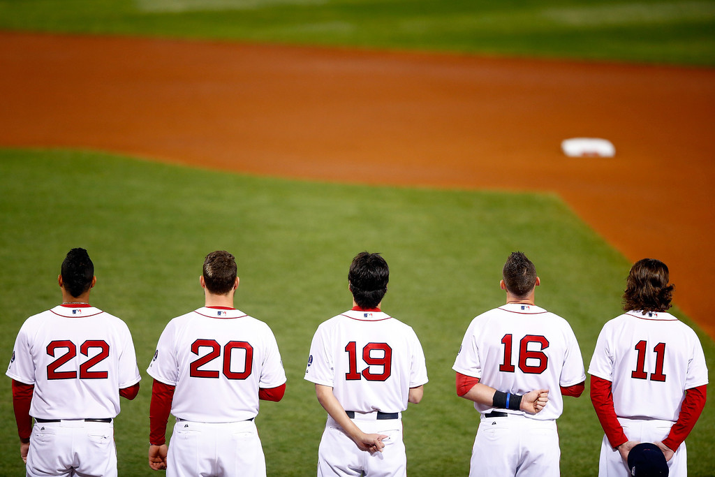 . The Boston Red Sox line up during the national anthem before Game One of the 2013 World Series against the St. Louis Cardinals at Fenway Park on October 23, 2013 in Boston, Massachusetts.  (Photo by Jared Wickerham/Getty Images)
