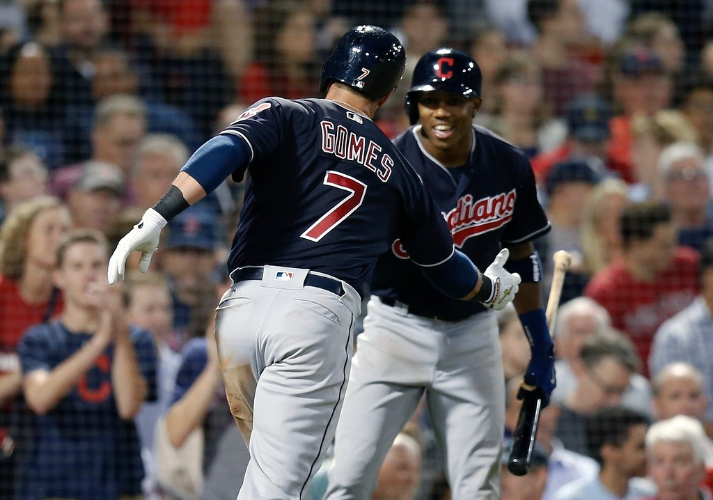. Cleveland Indians\' Yan Gomes (7) celebrates his solo home run with Greg Allen during the eighth inning of a baseball game against the Boston Red Sox in Boston, Tuesday, Aug. 21, 2018. (AP Photo/Michael Dwyer)