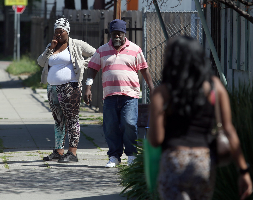 . Residents are seen on Seminary Avenue near 64th Avenue in Oakland, Calif., on Friday, April 12, 2013.  (Jane Tyska/Staff)
