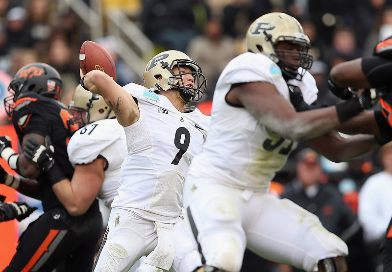 . Robert Marve #9 of the Purdue Boilermakers passes against the Oklahoma State Cowboys during the Heart of Dallas Bowl at Cotton Bowl on January 1, 2013 in Dallas, Texas.  (Photo by Ronald Martinez/Getty Images)