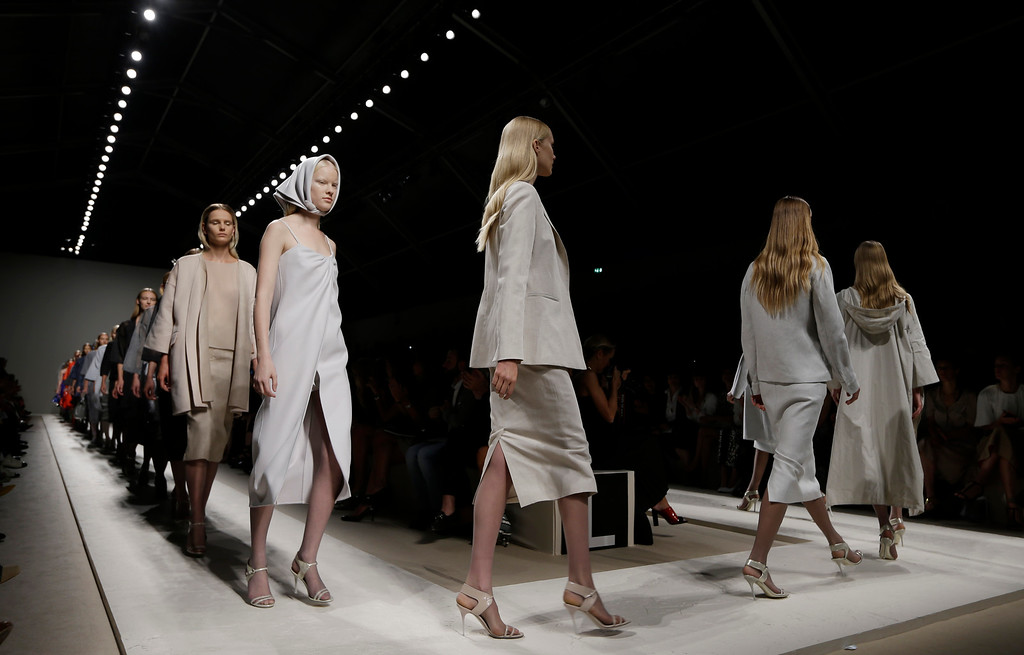 . Models wear creations for Max Mara women\'s Spring-Summer 2014 collection, part of the Milan Fashion Week, unveiled in Milan, Italy, Thursday, Sept. 19, 2013. (AP Photo/Luca Bruno)