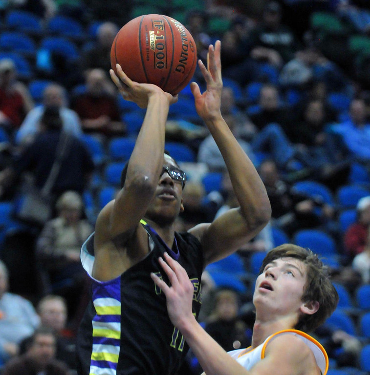. Cretin-Derham Hall\'s Jalan Ousley-Brown shoots over Bettendorf\'s (Iowa)  Michael Lintz in the first-half. (Pioneer Press: Scott Takushi)