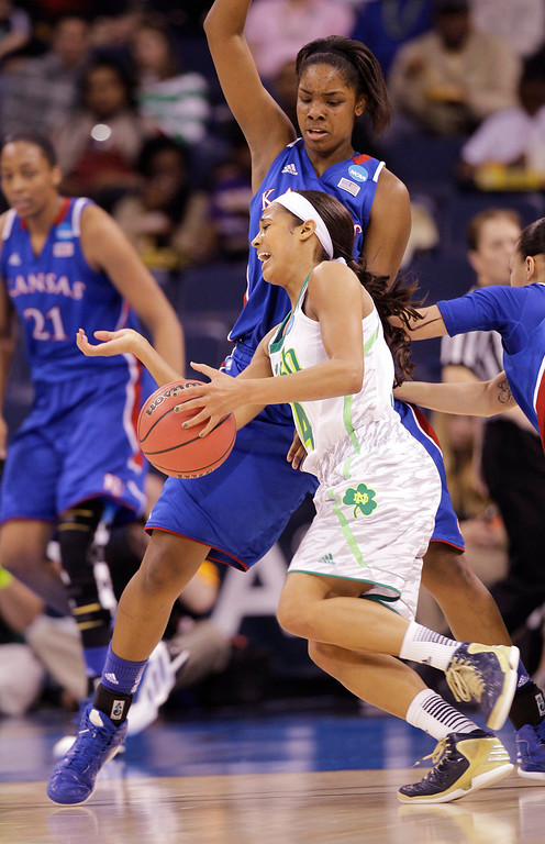. Notre Dame guard Skylar Diggins (4) slams into Kansas forward Chelsea Gardner (15) during the first half of a regional semi-final of the NCAA college basketball tournament Sunday  March 31, 2013 in Norfolk, Va.  (AP Photo/Steve Helber)