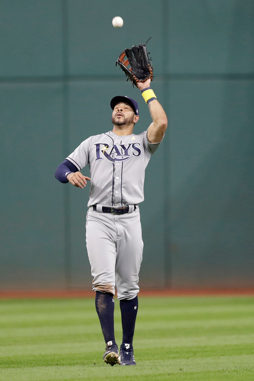 . Tampa Bay Rays\' Tommy Pham catches a ball hit by Cleveland Indians\' Yandy Diaz in the eighth inning of a baseball game, Saturday, Sept. 1, 2018, in Cleveland. Diaz was out on the play. (AP Photo/Tony Dejak)