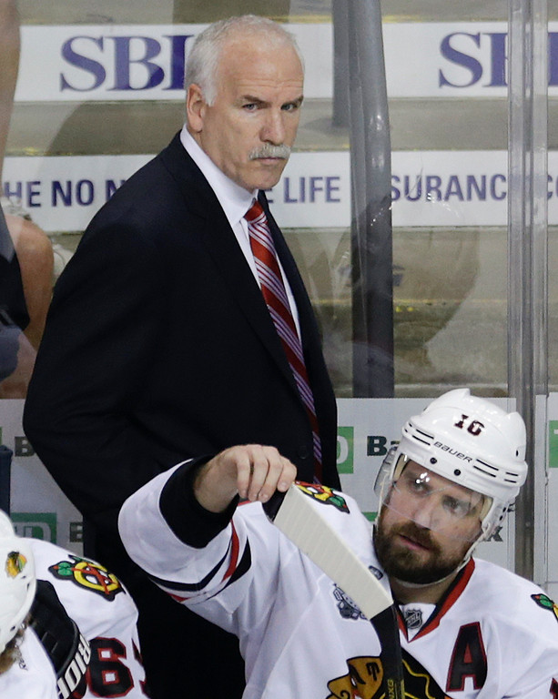 . Chicago Blackhawks head coach Joel Quenneville walks behind the bench during the second period in Game 6 of the NHL hockey Stanley Cup Finals against the Boston Bruins, Monday, June 24, 2013, in Boston. (AP Photo/Charles Krupa)