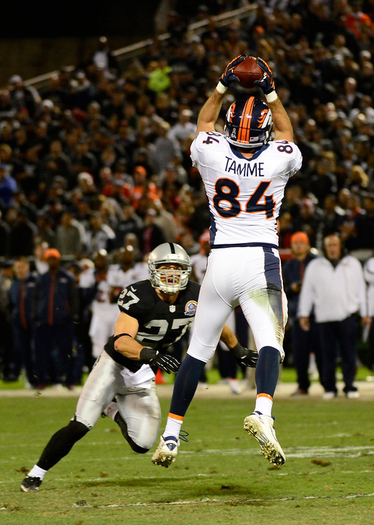 . Denver Broncos tight end Jacob Tamme #84 goes up for a catch on Oakland Raiders free safety Matt Giordano #27 during the first quarter  at the O.co Coliseum, in Oakland , CA December 06, 2012.      Joe Amon, The Denver Post