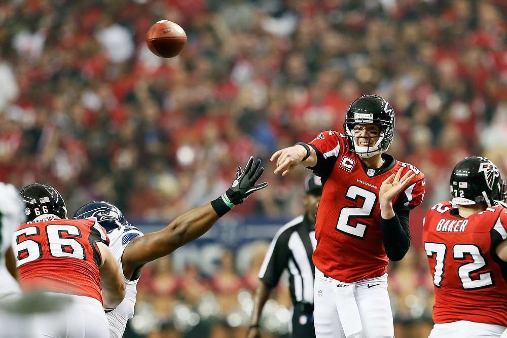 Description of . Matt Ryan #2 of the Atlanta Falcons throws the ball against the Seattle Seahawks during the NFC Divisional Playoff Game at Georgia Dome on January 13, 2013 in Atlanta, Georgia.  (Photo by Kevin C. Cox/Getty Images)