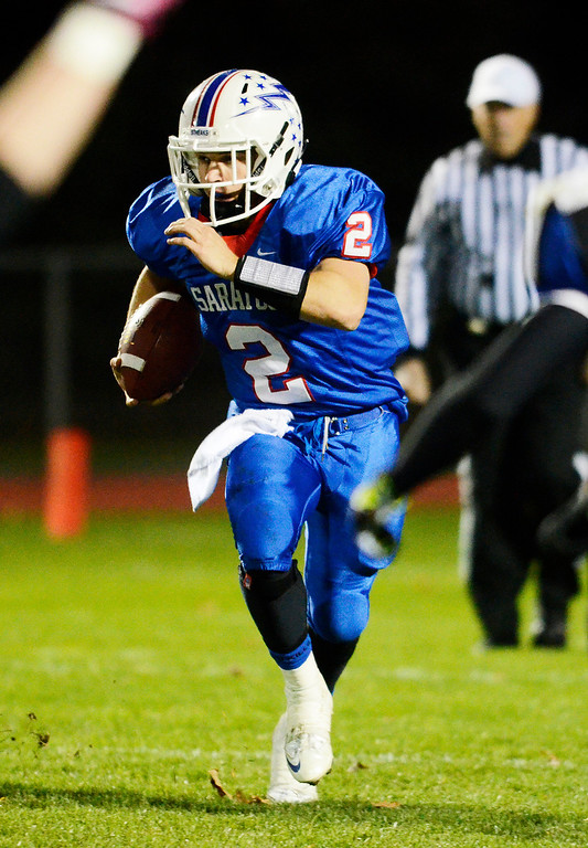 . Erica Miller - The Saratogian @togianphotog      Saratoga\'s Jake Eglintine runs down the field during their playoff football game against LaSalle on Friday evening under the lights in Saratoga. SAR-l-SarFootball4