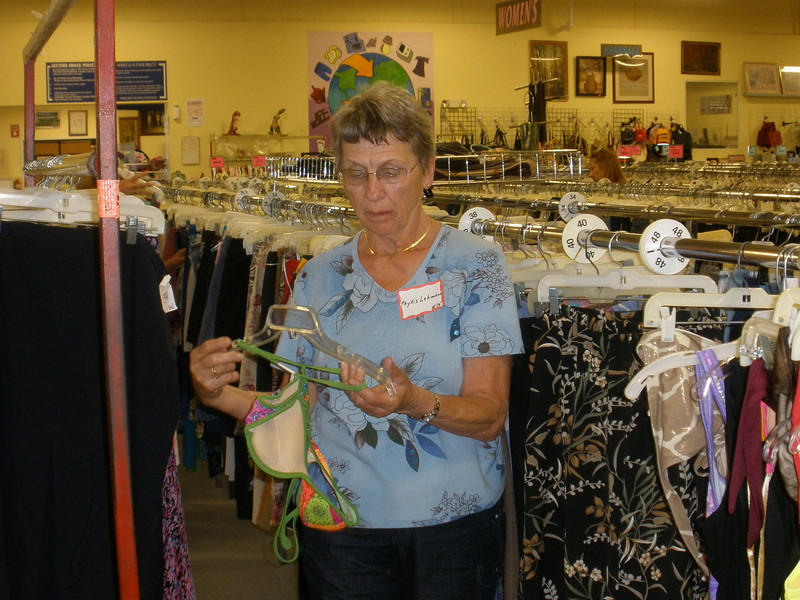 Phyllis rehanging a clothing item