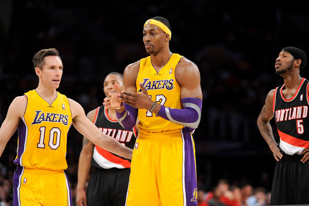. The Lakers\' Dwight Howard gets a pat from Steve Nash after the Trail Blazers\' intentionally fouled Howard in the second quarter, Friday, December 28, 2012, at Staples Center. (Michael Owen Baker/L.A. Daily News)