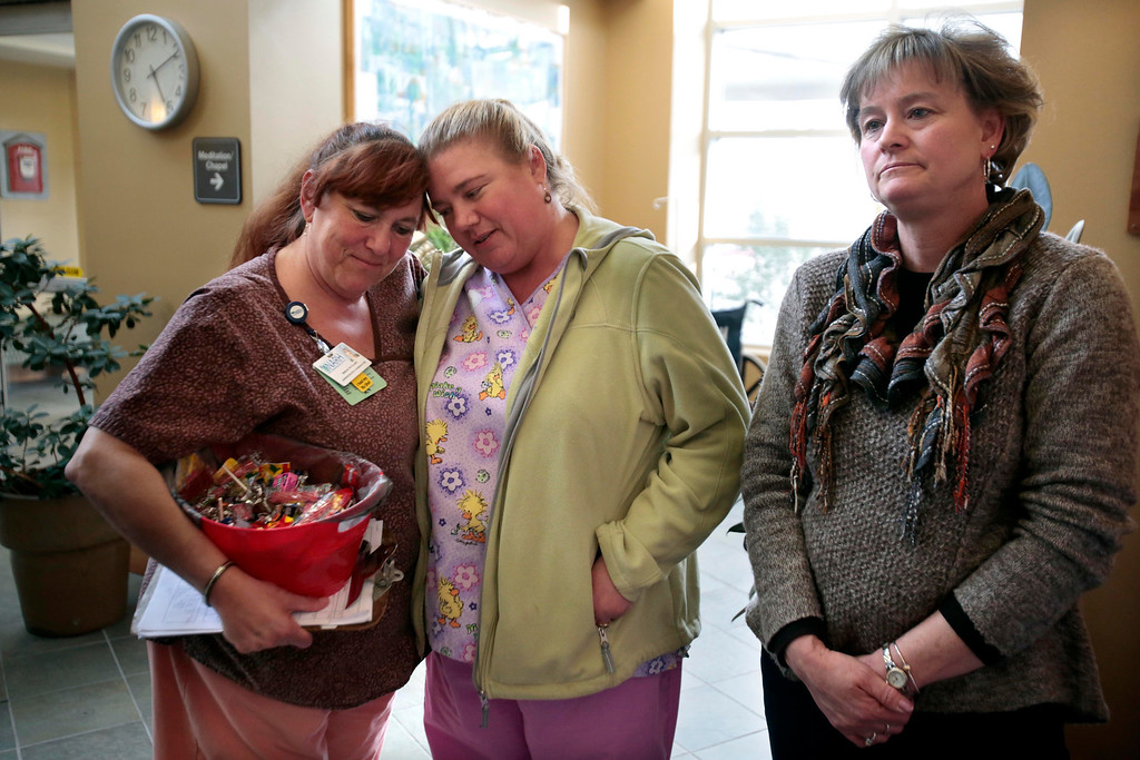 . Nurses Miriam Duval, left, and Karin Robert console each other beside Robbin Simonetti after the sudden announcement of the closure of the North Adams Regional Hospital on Tuesday, March 25, 2014. Stephanie Zollshan / Berkshire Eagle Staff / photos.berkshireeagle.com