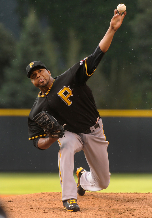 . DENVER, CO. - AUGUST 09: Pirates starting pitcher Francisco Liriano released the ball in the first inning. The Colorado Rockies hosted the Pittsburgh Pirates Friday night, August 9, 2013. Photo By Karl Gehring/The Denver Post