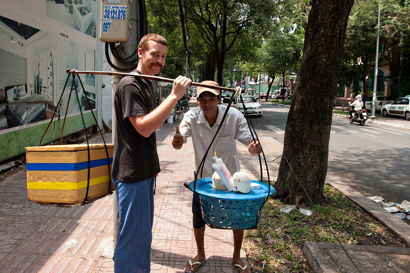 A street vendor gives us a chance to try out his carrying stick. They are pretty cool!