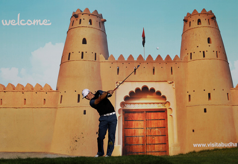 . Backdropped by a picture poster, Thorbjorn Olesen of Denmark tees off on the 15th hole during the first round of Abu Dhabi Golf Championship in Abu Dhabi, United Arab Emirates, Thursday, Jan. 17, 2013. (AP Photo/Kamran Jebreili)