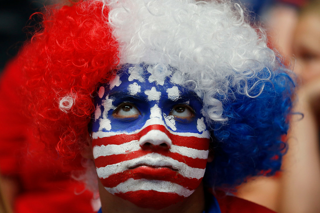 . Tommy Martinez, of Midlothian, looks toward the video board late in regulation time during a watch party for the World Cup soccer match between the United States and Belgium in Arlington, Texas, Tuesday, July 1, 2014. (AP Photo/The Dallas Morning News, Andy Jacobsohn)