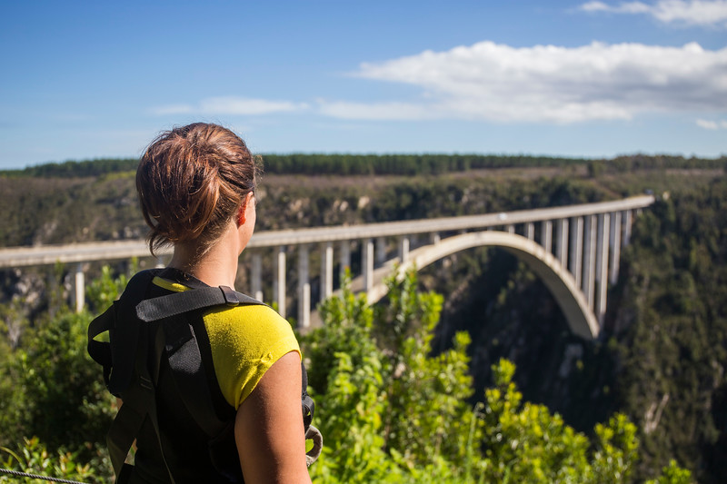woman looking out over bridge