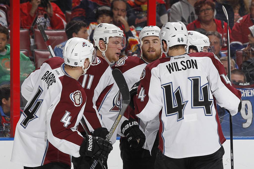 . SUNRISE, FL - JANUARY 24: Jamie McGinn #11 of the Colorado Avalanche is congratulated by teammates after scoring a second period goal against the Florida Panthers at the BB&T Center on January 24, 2014 in Sunrise, Florida. (Photo by Joel Auerbach/Getty Images)