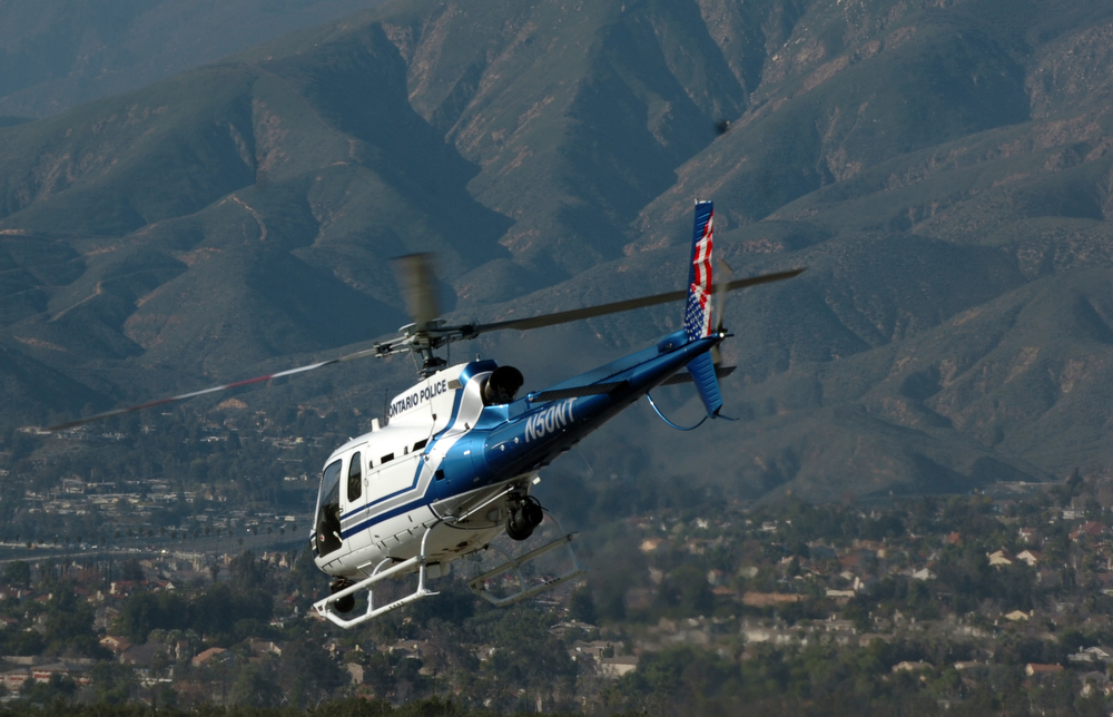 . Police helicopters fly out of Redlands Airport as police move in on Christopher Dorner in the Big Bear area February 12, 2013.  (Thomas R. Cordova/Staff Photographer)