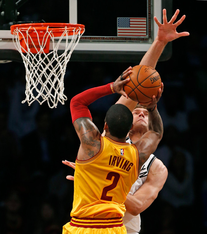. Brooklyn Nets center Brook Lopez (11) defends Cleveland Cavaliers guard Kyrie Irving (2) in the second half of an NBA basketball game, Thursday, March 24, 2016, in New York. The Nets upset the Cavaliers 104-95. (AP Photo/Kathy Willens)