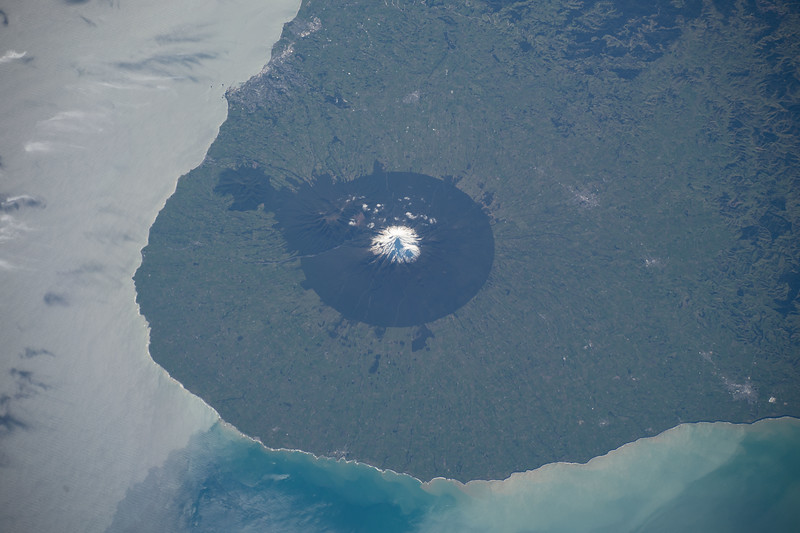 """An active stratovolcano, it's name means """"shining mountain peak"""" due to the snow on top in the winter months. It's part of the """"Ring of Fire."""" ISS over the southwestern Pacific. (ANSWER: Mount Taranaki in New Zealand.)"""