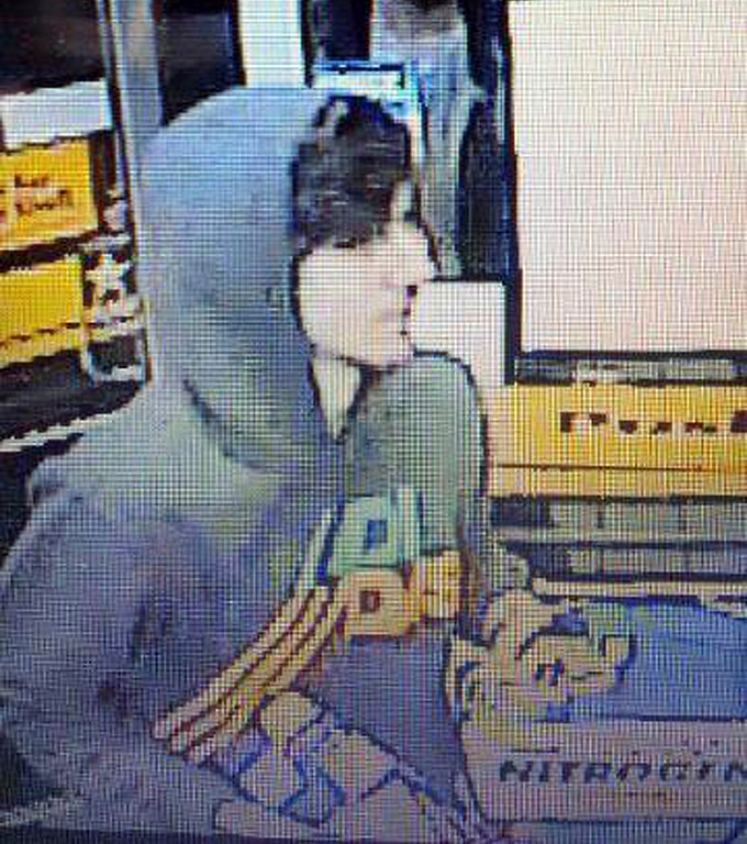 . This surveillance photo released via Twitter Friday, April 19, 2013 by the Boston Police Department shows a suspect entering a convenience store that police are pursuing in Watertown, Mass.  Police say he is one of two suspects in the fatal shooting of an MIT police officer and tied to the Boston Marathon bombing. (AP Photo/Boston Police Department)