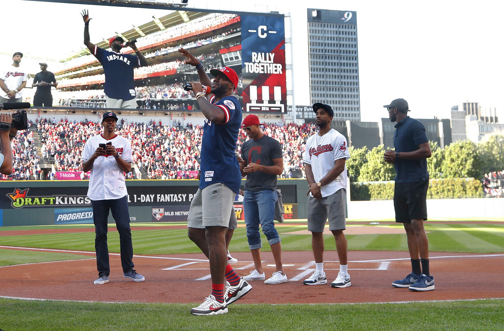 . Cleveland Cavaliers\' Lebron James, center, speaks to fans before Game 2 of baseball\'s American League Division Series between the Cleveland Indians and the Boston Red Sox, Friday, Oct. 7, 2016. (AP Photo/Paul Sancya)