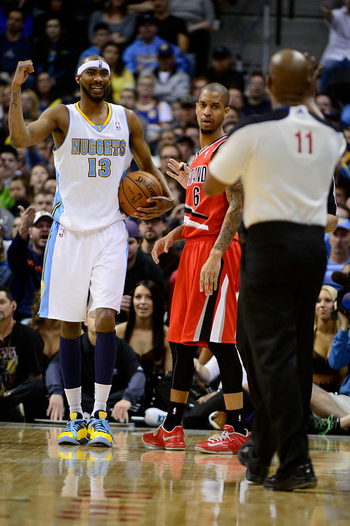 . DENVER, CO - APRIL 14: Corey Brewer (13) of the Denver Nuggets questions a possession call as Eric Maynor (6) of the Portland Trail Blazers looks on during the second half of action. The Denver Nuggets defeat the Portland Trail Blazers 118-109 at the Pepsi Center. (Photo by AAron Ontiveroz/The Denver Post)