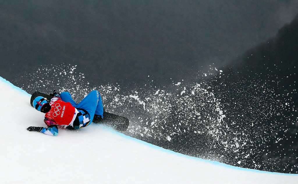 . Austria\'s Allessandro Haemmerle crashes during a men\'s snowboard cross quarterfinal at the Rosa Khutor Extreme Park, at the 2014 Winter Olympics, Tuesday, Feb. 18, 2014, in Krasnaya Polyana, Russia. (AP Photo/Sergei Grits)