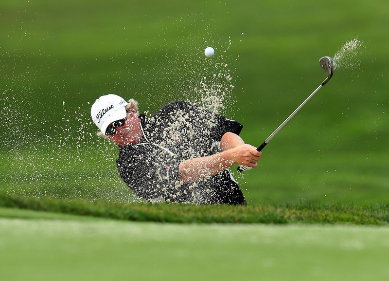 . Brad Fritsch hits out of a bunker on the sixth hole during the third round of the Farmers Insurance Open on the South Course at Torrey Pines Golf Course on January 27, 2013 in La Jolla, California.  (Photo by Stephen Dunn/Getty Images)