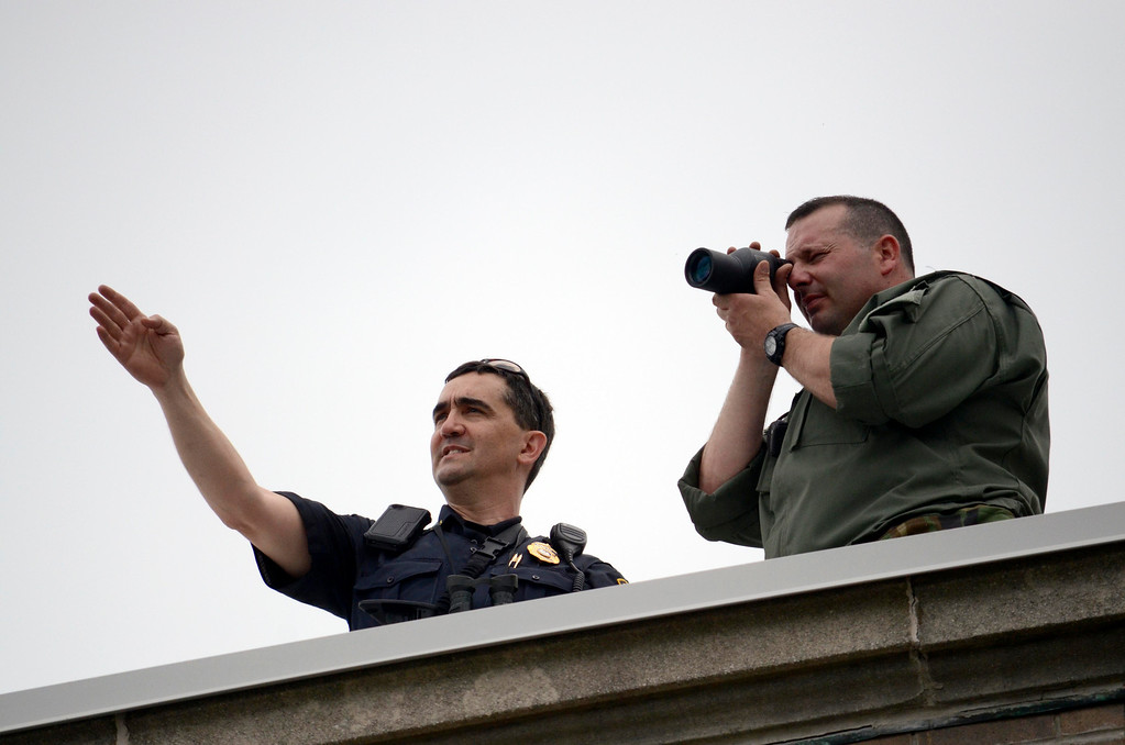. SRT snipers Sgt Mark Trapani (left, Pittsfield) and Craig DeSantis (Lee) use a courthouse rooftop as a vantage point for security for the pre-trial hearing on the Triple murder case.  Wed May 22, 2013 (GARVER)