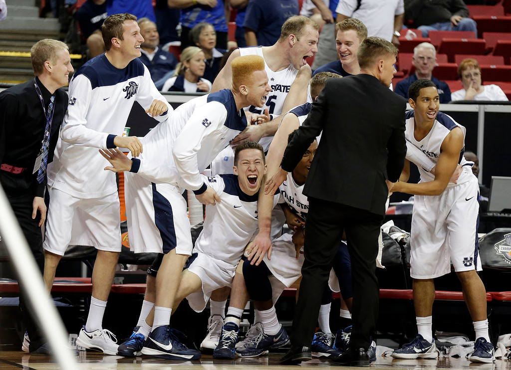 . Utah State\'s bench reacts as Colorado State\'s Daniel Bejarano is called for a technical foul during the second half of a Mountain West Conference tournament NCAA college basketball game Wednesday, March 12, 2014, in Las Vegas. Utah State won 73-69. (AP Photo/Isaac Brekken)