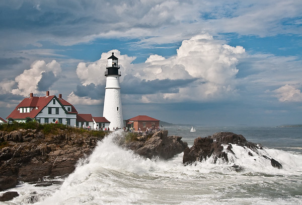 Waves from hurricane Bill, 2009, at Portland Head lighthouse on Casco Bay, Maine.