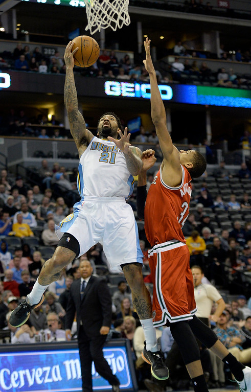 . DENVER, CO - MARCH 03: Wilson Chandler (21) of the Denver Nuggets lays the ball up as Giannis Antetokounmpo (34) of the Milwaukee Bucks defends during the second quarter of action. The Denver Nuggets hosted the Milwaukee Bucks at the Pepsi Center on Tuesday, March 3, 2015. (Photo by AAron Ontiveroz/The Denver Post)