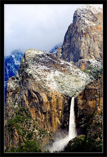 Cathedral Rocks & Bridalveil Fall After Spring Storm  A late-spring storm brings snow to Cathedral Rocks above Bridalveil Creek.  Yosemite National Park, California  15-MAY-2011