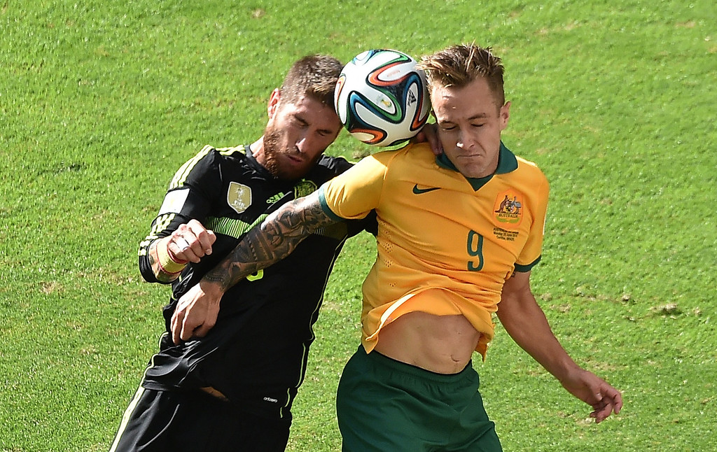 . Spain\'s defender Sergio Ramos (L) vies with Australia\'s forward Adam Taggart (R) during a Group B football match between Australia and Spain at the Baixada Arena in Curitiba during the 2014 FIFA World Cup on June 23, 2014.  AFP PHOTO / LUIS  ACOSTA/AFP/Getty Images