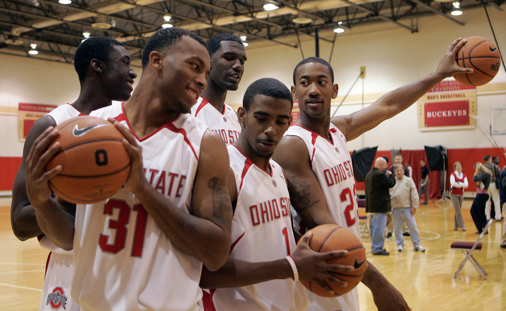 . Ohio State freshman basketball players joke around as they prepare for a group picture Thursday, Oct. 12, 2006 during the basketball media day in Columbus, Ohio. Front row from left are Daequan Cook (31), Mike Conley (1) and David Lighty (23). Behind them are Othello Hunter, left, and Greg Oden. (AP Photo/Kiichiro Sato)