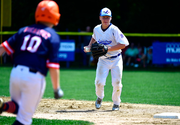 8/4/2019 Mike Orazzi | Staff Massachusetts's Paul McCarthy (10) forced out at second by Maine's Jeffrey Randall (10) during their opening round game of the New England Regional Little League Baseball Tournament in Bristol on Sunday.