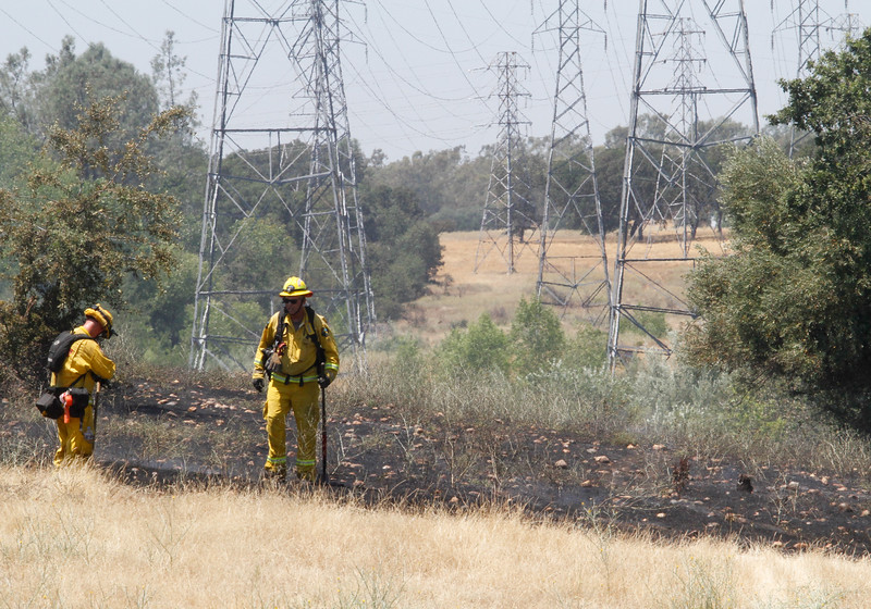 Cal Fire Butte County and El Medio Fire quickly worked to hold a vegetation fire to 3-4 acres along Pinecrest Road July 3, 2017 in Oroville, California.  (Emily Bertolino -- Mercury-Register)