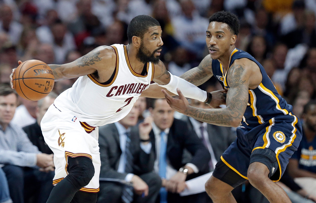 . Cleveland Cavaliers\' Kyrie Irving, left, drives past Indiana Pacers\' Jeff Teague in the second half in Game 2 of a first-round NBA basketball playoff series, Monday, April 17, 2017, in Cleveland. The Cavaliers won 117-111. (AP Photo/Tony Dejak)