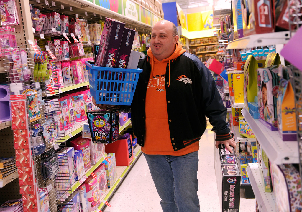 . Rich O\'Kelley got some shopping done Thursday night at the Toys R Us store on County Line Road in Arapahoe County. Many metro area stores got a jump on Black Friday by opening Thanksgiving night. Photo By Karl Gehring/The Denver Post