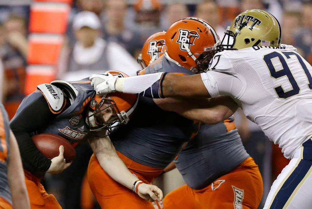 . Pittsburgh defensive lineman Aaron Donald (97) reaches in on Bowling Green quarterback Matt Johnson during the first half of the Little Caesars Pizza Bowl NCAA college football game, Thursday, Dec. 26, 2013, in Detroit. (AP Photo/Carlos Osorio)