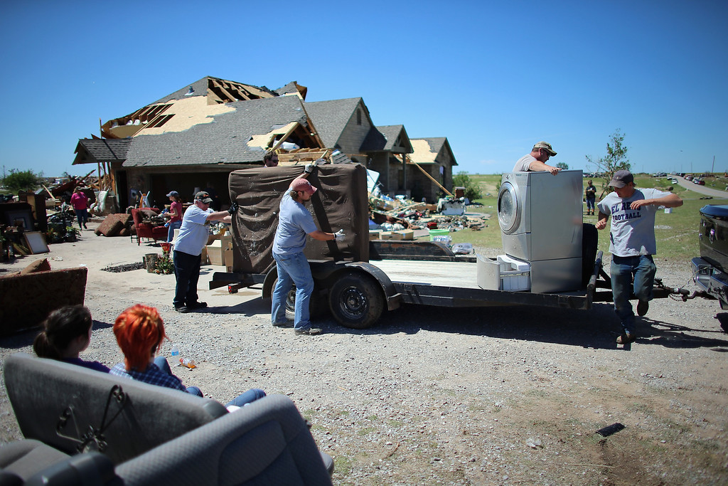 . EL RENO, OK - JUNE 01: A family loads what they have salvaged, with the help of friends, from their damaged home after a tornado hit on June 1, 2013 in El Reno, Oklahoma. The tornado ripped through the area last night killing at least nine people, injuring many others and destroying homes and buildings.  (Photo by Joe Raedle/Getty Images)