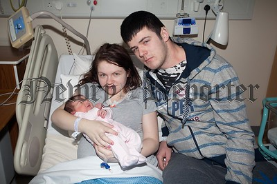 Chelsea McGirr and Gary johnston from Hilltown are pictured with baby Robyn Johnston who was born on Christmas Day weighing 7lb 14oz. R1601007