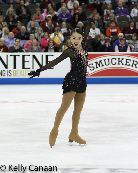 Karen Chen poses mid-program during her free skate in Kansas CIty. She won gold.