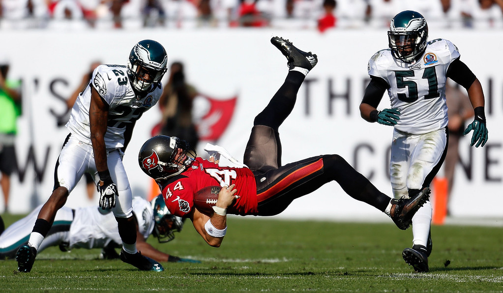 . TAMPA, FL - DECEMBER 09:  Tight end Dallas Clark #44 of the Tampa Bay Buccaneers catches a pass in front of defenders Dominique Rodgers-Cromartie and Jamar Chaney #51 of the Philadelphia Eagles during the game at Raymond James Stadium on December 9, 2012 in Tampa, Florida.  (Photo by J. Meric/Getty Images)