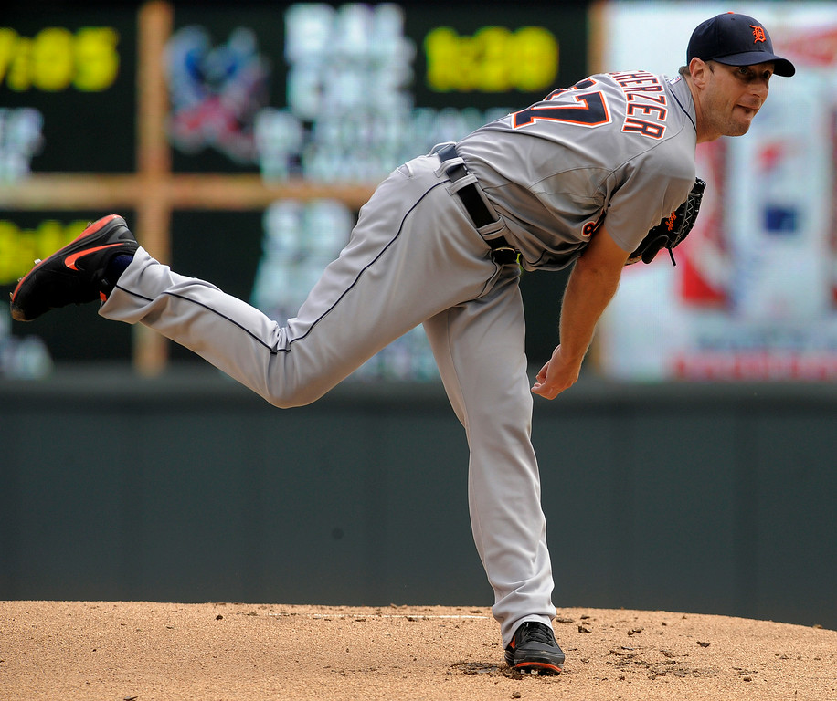 . Detroit Tigers� Max Scherzer pitches against the Minnesota Twins during the first inning of a baseball game Sunday, Aug. 24, 2014, in Minneapolis. (AP Photo/Tom Olmscheid)