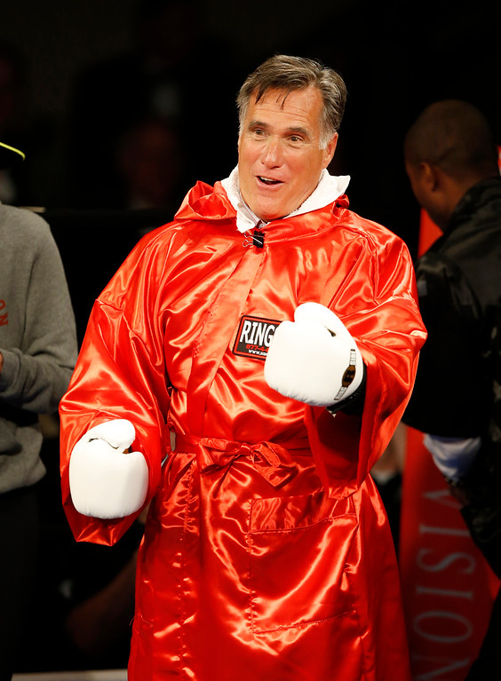 ". Mitt Romney taunts Evander Holyfield before a charity boxing event on May 15, 2015 in Salt Lake City, Utah. The event was held to raise money for  ""Charity Vision\"" a charity that aims to restore sight to the blind and visually impaired. (Photo by George Frey/Getty Images)"